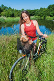Young woman with bicycle and cute dog Stock Images