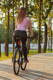 Young woman on bicycle Royalty Free Stock Photo