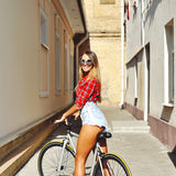Young woman with bicycle. Outdoor lifestyle portrait Royalty Free Stock Photography