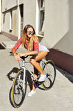 Young woman with bicycle. Outdoor lifestyle portrait Stock Image