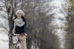 Young woman on the bicycle Stock Images