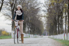 Young woman on the bicycle Royalty Free Stock Image