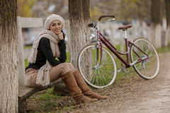 Young woman with a bicycle Royalty Free Stock Images