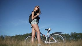 Young woman with bicycle stock footage
