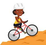 Young woman on bicycle traveling in the mountains. Royalty Free Stock Photography