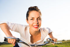 Young woman on the bicycle royalty free stock photography