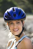 Young woman bicycling. Royalty Free Stock Images