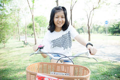 Young woman bicycling. Stock Photo