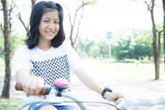Young woman bicycling. Royalty Free Stock Photography