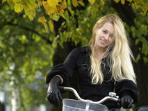 Young woman on bicylce Royalty Free Stock Photos