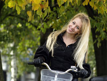 Young woman on bicylce Stock Photo