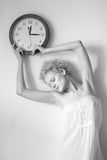 Young woman with big clock in hands. Stock Photo
