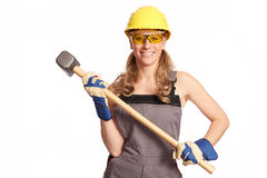 Young woman with a big hammer Stock Images