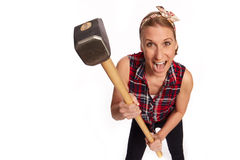 Young woman with a big hammer.  Royalty Free Stock Photography