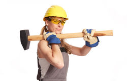 Young woman with a big hammer.  Stock Photos