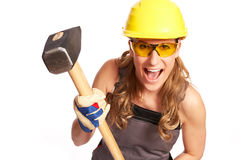 Young woman with a big hammer Stock Photos