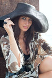 Young woman in big hat Royalty Free Stock Photography