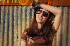 Young Woman with Big Headphone in Army Camouflage T-shirt Royalty Free Stock Photo