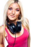 Young woman with big headphones Royalty Free Stock Images
