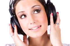 Young woman with big headphones Royalty Free Stock Photography