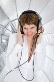 Young woman in a big headphones looking in camera Stock Photography