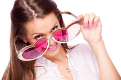 Young woman with big heart sunglasses Royalty Free Stock Photo