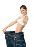 Young woman with big jeans. looking at camera. isolate Royalty Free Stock Photo