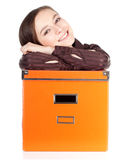 Young woman with big orange box Royalty Free Stock Photography