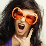 Young woman with big orange sunglasses Royalty Free Stock Images