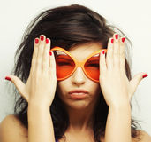 Young woman with big orange sunglasses. Young funny woman with big orange sunglasses Stock Photography