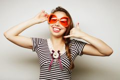 Young woman with big party glasses Royalty Free Stock Photography