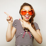 Young woman with big party glasses Stock Photo