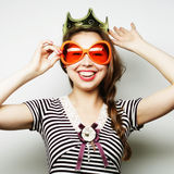 Young woman with big party glasses Royalty Free Stock Images