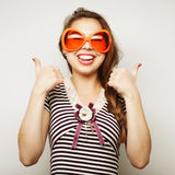 Young woman with big party glasses Stock Images