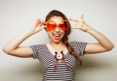 Young woman with big party glasses Stock Photography