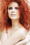 Young woman with big red curly hair. Stock Photo
