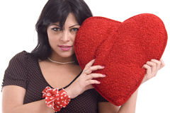 Young woman with big red plush heart Royalty Free Stock Photos