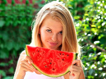 Young Woman with big slice Watermelon Berry fresh in hands Beautiful Smiling Face Stock Photos