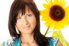 Young woman with a big sun flower Royalty Free Stock Images