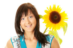 Young woman with a big sun flower Royalty Free Stock Photography
