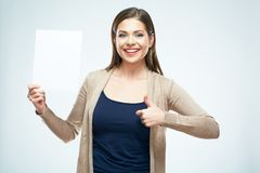 Young woman with big toothy smile hold white blank sign board. And show thumb up Stock Images