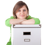 Young woman and big white box Royalty Free Stock Images