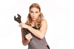 Young woman with a big wrench Royalty Free Stock Images