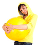 Young woman with big, yellow ball Royalty Free Stock Images