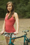 Young Woman with bike Royalty Free Stock Photos