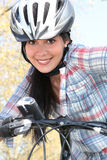 Young woman on a bike. Smiling woman on a bike Stock Photography