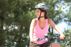 Young woman on a bike Stock Photography