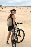 Young woman with bike Stock Images