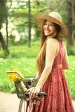 Young woman and bike Stock Image