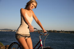 Young woman with bike Stock Image